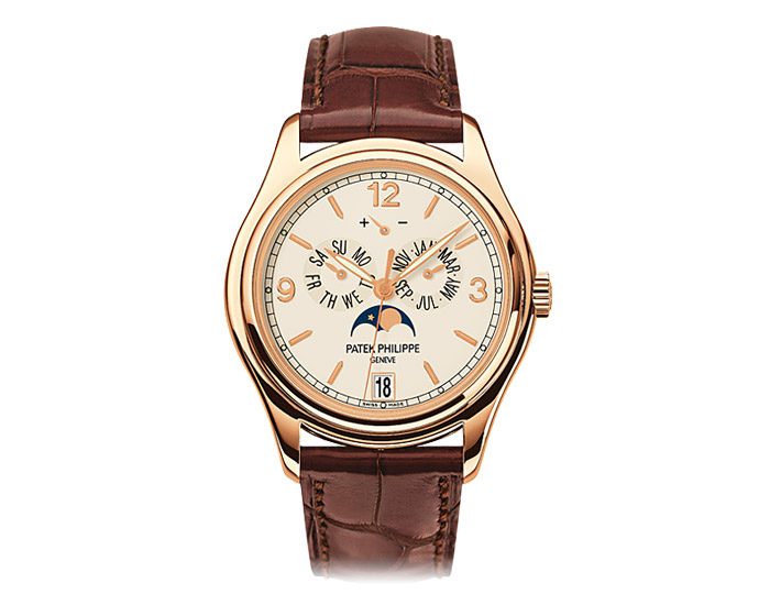 Patek Philippe annual calendar men's 18k rose gold mechanical self-winding strap watch featuring day and month by hands, date in an aperture and moon phases with a cream dial. (5146R-001)