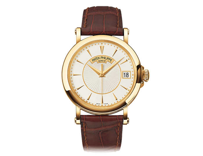 Patek Philippe Calatrava mens 18k yellow gold mechanical self-winding strap watch featuring a center sweep second hand, hinged cover case back and silvery opaline dial.  (5153G-001)
