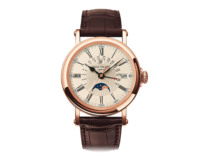 Patek Philippe perpetual calendar men's 18k rose gold mechanical self-winding strap watch featuring retrograde day with date, month, leap year by apertures and moon phases with a white opaline dial. (5159R-001)