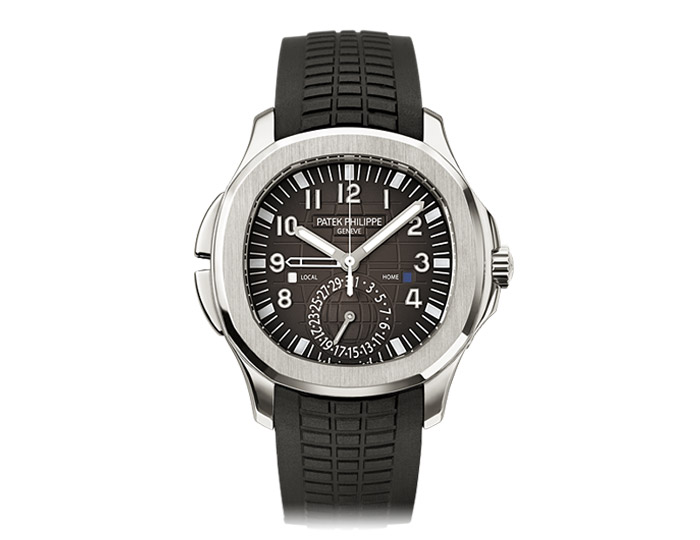 Patek Philippe Aquanaut mens stainless steel mechanical self-winding composite strap watch featuring  dual time zone indicating local and home time, day/night indication in apertures, local date by hand with a black embossed dial.  (5164A-001)