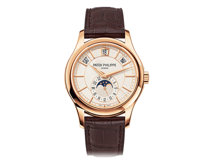 Patek Philippe annual calendar men's 18k rose gold mechanical self-winding strap watch featuring day, date and month in apertures, moon phases and 24-hour dial with opaline white dial. (5205R-001)