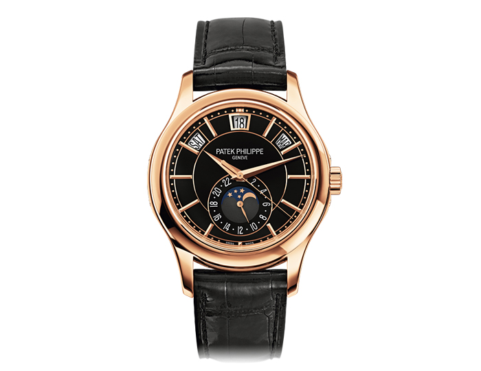 Patek Philippe annual calendar men's 18k rose gold mechanical self-winding strap watch featuring day, date and month in apertures, moon phases and 24-hour dial with black lacquered dial. (5205R-010)