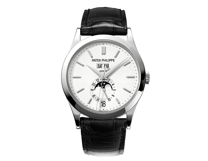 Patek Philippe annual calendar men's 18k white gold mechanical self-winding strap watch featuring day, date and month in apertures, moon phases and 24-hour indication with a silvery opaline dial. (5396G-011)