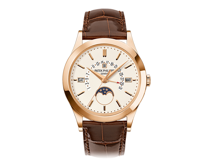 Patek Philippe perpetual calendar men's 18k rose gold mechanical self-winding strap watch featuring day, date, month, leap year and moon phases with a silver opaline dial. (5496R-001)