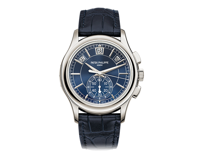 Patek Philippe annual calendar chronograph men's platinum mechanical self-winding strap watch featuring day, date and month in apertures with blue sunburst dial. (5905P-001)