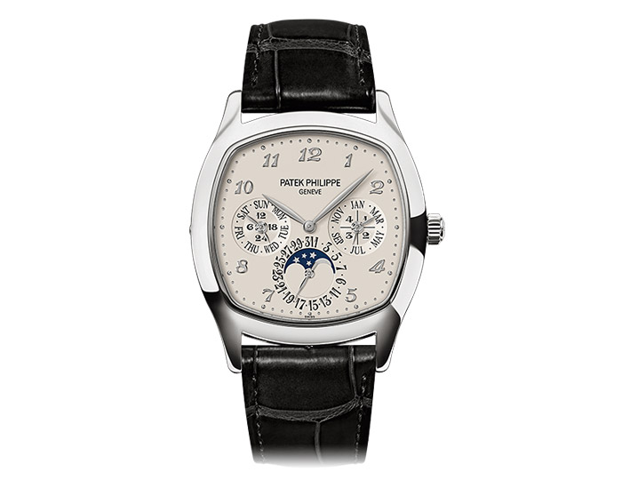 Patek Philippe perpetual calendar mens 18k white gold mechanical self-winding strap watch featuring day, date, month, leap year by hands, moon phases and 24-hour indicator with a velvety silver white dial.  (5940G-001)