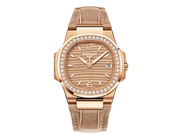 Patek Philippe Nautilus ladies 18k rose gold diamond case strap watch featuring date in an aperture with a golden dial.  (7010R-012)