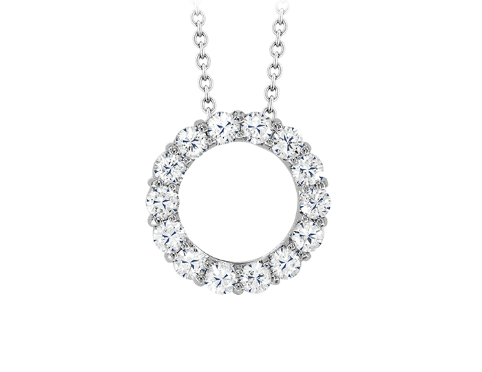 Roberto Coin Tiny Treasures Collection round brilliant cut diamond Circle-of-Life pendant in 18k white gold.