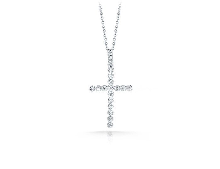 Roberto Coin Tiny Treasure Collection diamond cross in 18k white gold.