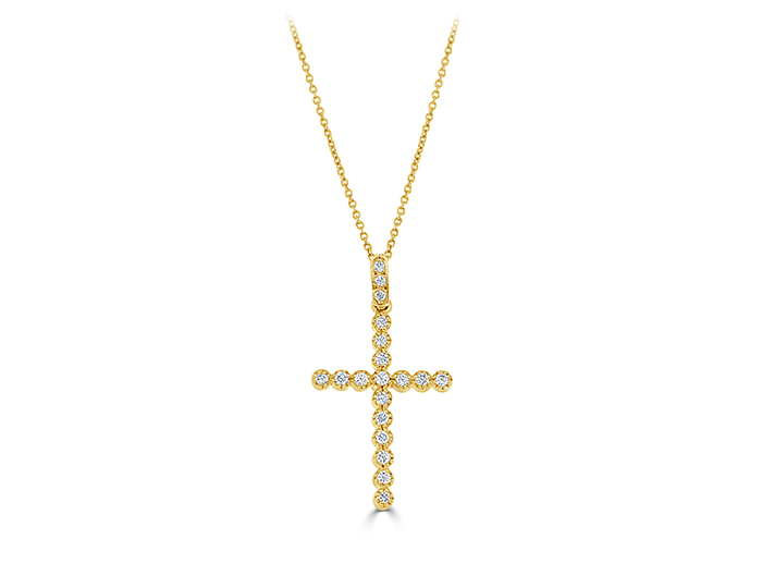 Roberto Coin round brilliant cut diamond cross in 18k yellow gold.