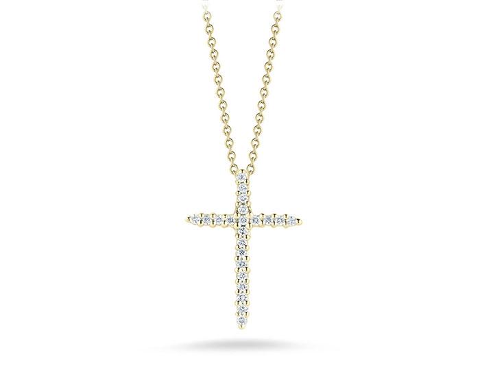 Roberto Coin round brilliant cut diamond cross in 18k yellow gold.