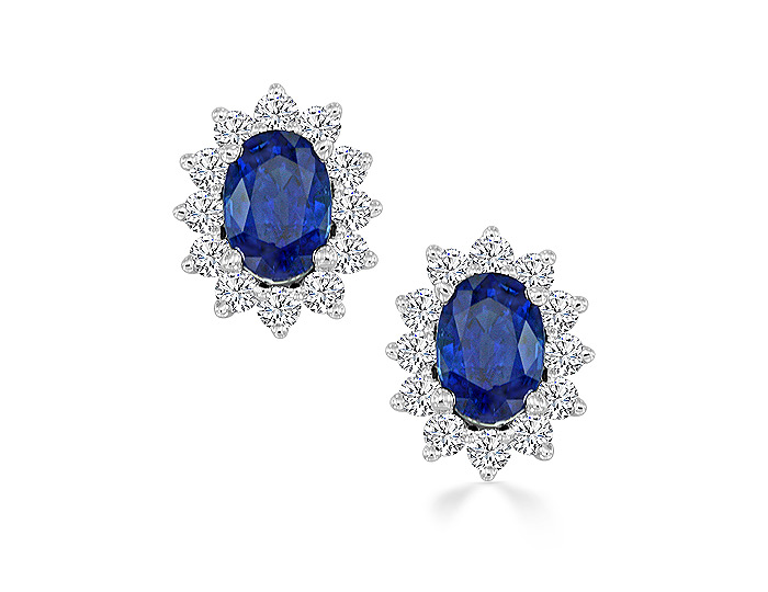 Oval shape sapphire and round brilliant cut diamond earrrings in 18k white gold.