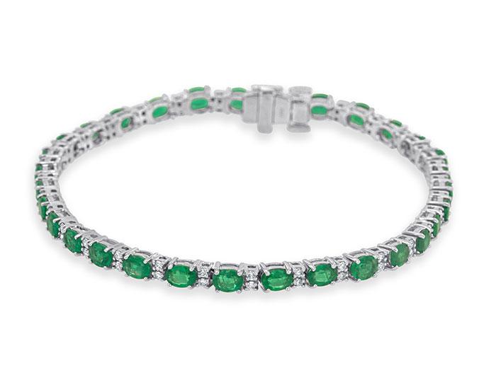 Emerald and round brilliant cut diamond bracelet in 18k white gold.