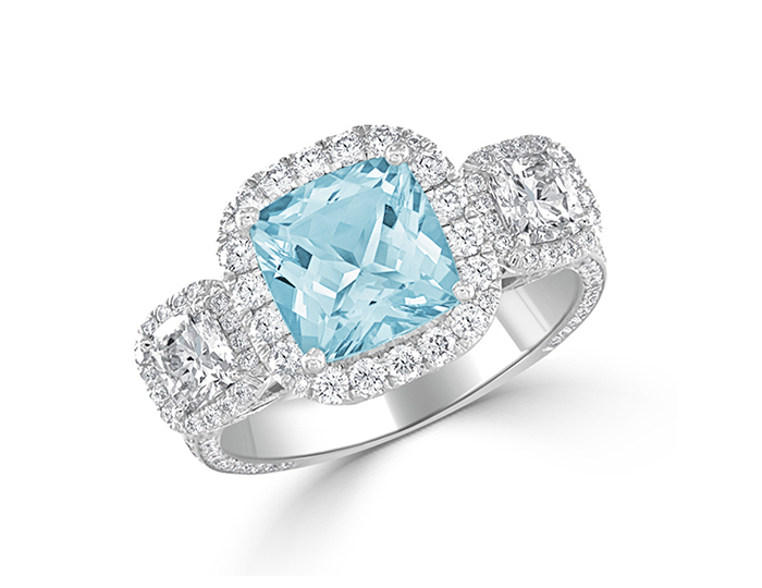 Aquamarine with cushion and round brilliant cut diamonds in platinum.