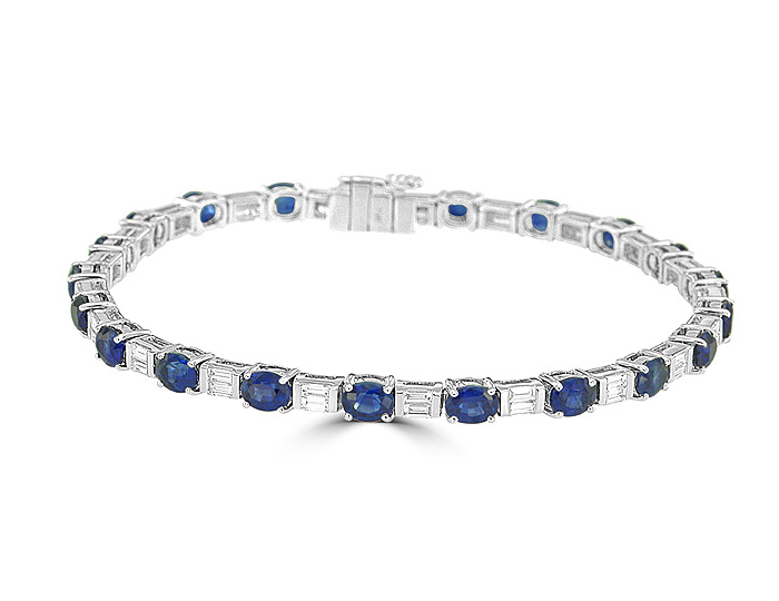 Oval shape sapphire and baguette cut diamond bracelet in 18k white gold.