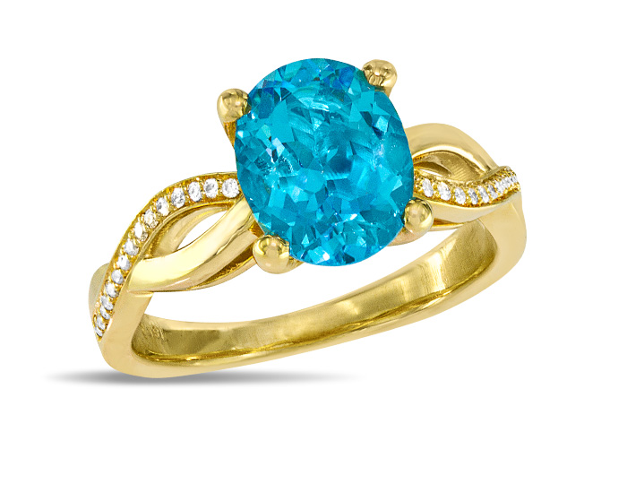 Blue topaz and round brilliant cut diamond ring in 18k yellow gold.