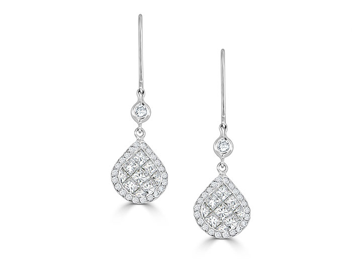 Quadrillion cut and round brilliant cut diamond earrings in 18k white gold.