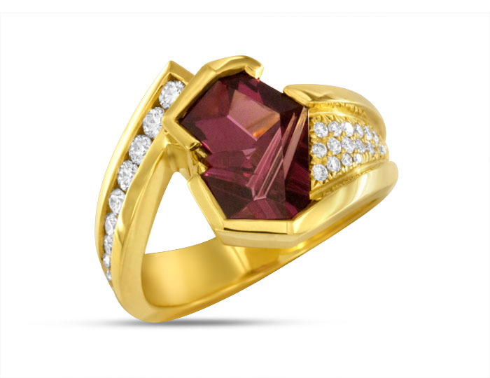 Bernd Munsteiner cut rhodolite garnet and round brilliant diamond ring in 18k yellow gold.