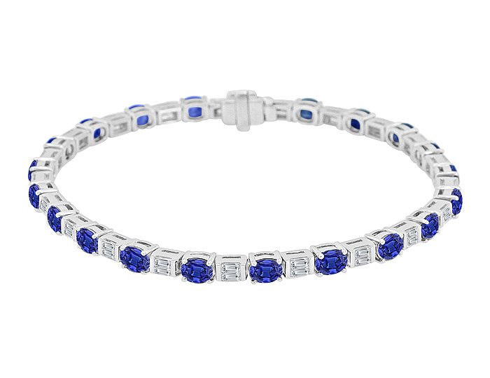 Oval sapphire and baguette cut diamond bracelet in 18k white gold.