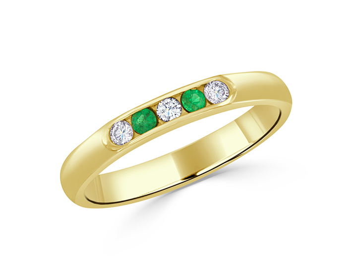 Emerald and round brilliant cut diamond ring in 14k yellow gold.