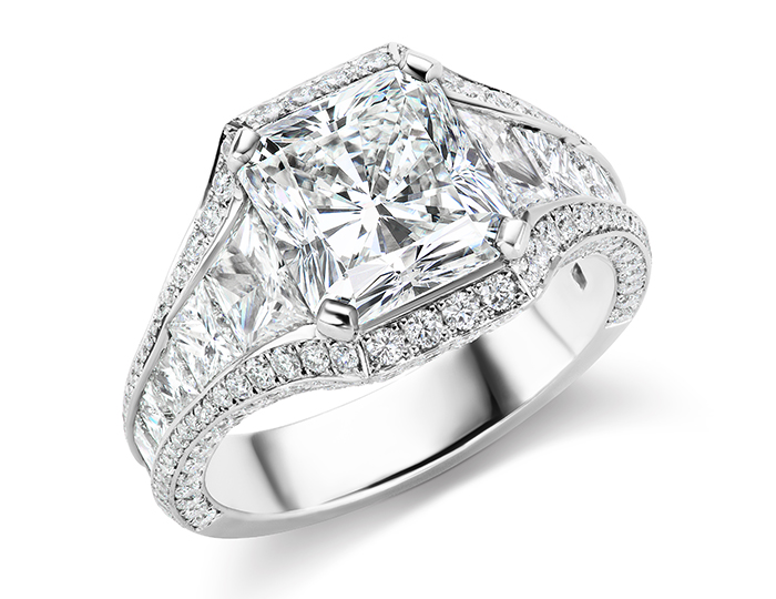 Radiant, princess, trapezoid and round brilliant cut diamond ring in platinum.