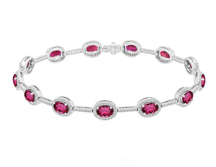 Oval shape ruby and round brilliant cut diamond bracelet in 18k white gold.
