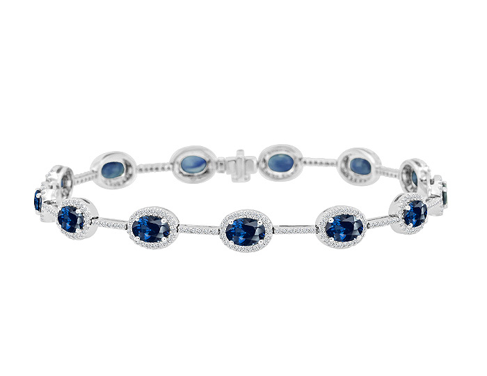 Oval sapphire and round brilliant cut diamond bracelet in 18k white gold.