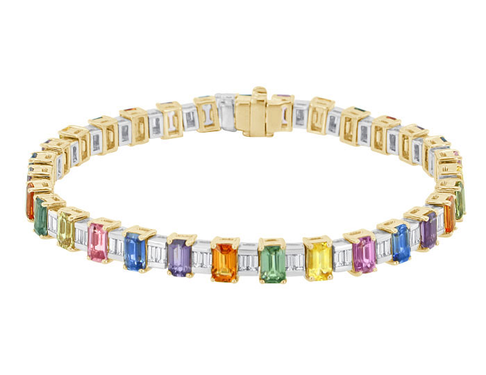 Emerald cut fancy colored sapphire and baguette cut diamond bracelet in 18k yellow and white gold.
