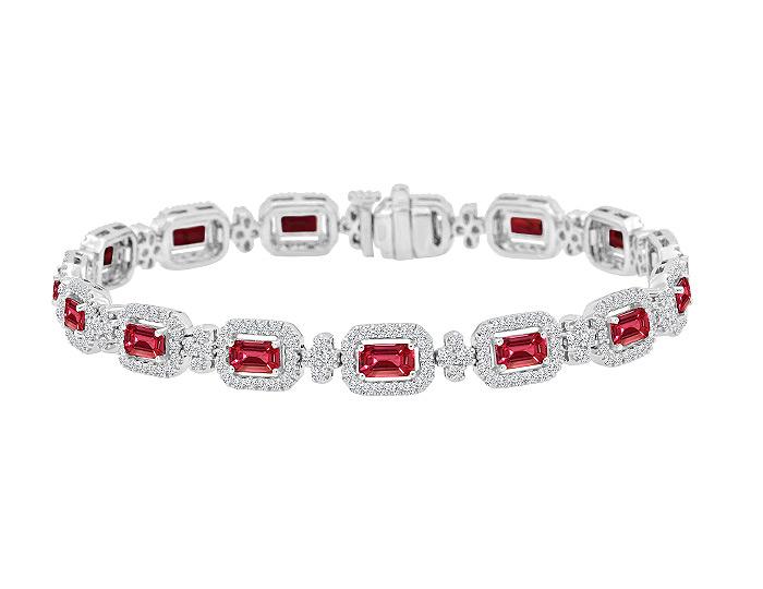 Emerald cut ruby and round brillint cut diamond bracelet in 18k white gold.