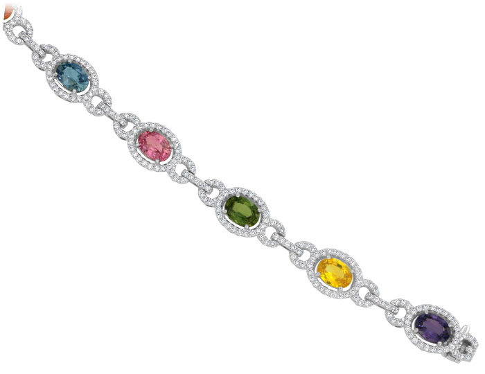 Fancy sapphire and round brilliant cut diamond bracelet in 18k white gold.