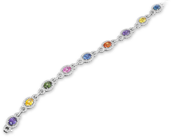 Fancy color sapphire and round brilliant cut diamond bracelet in 18k white gold.