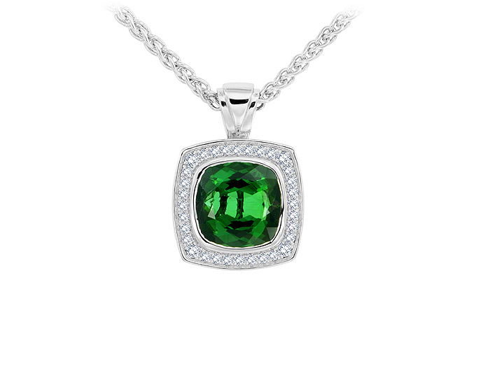Cushion cut green tourmaline and round brilliant cut diamond pendant in 18k white gold.