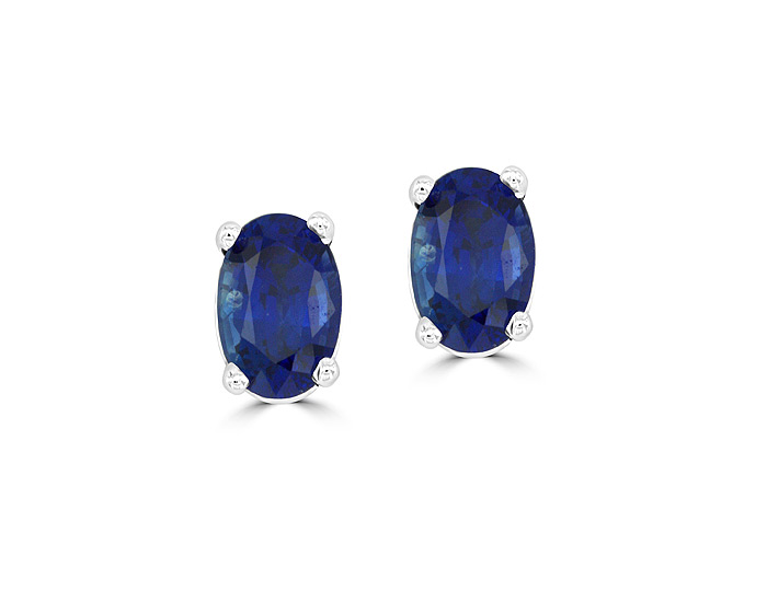 Oval shape sapphire earrings in 18k white gold.