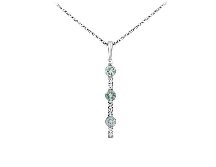 Green sapphire and round brilliant cut diamond pendant in 14k white gold.
