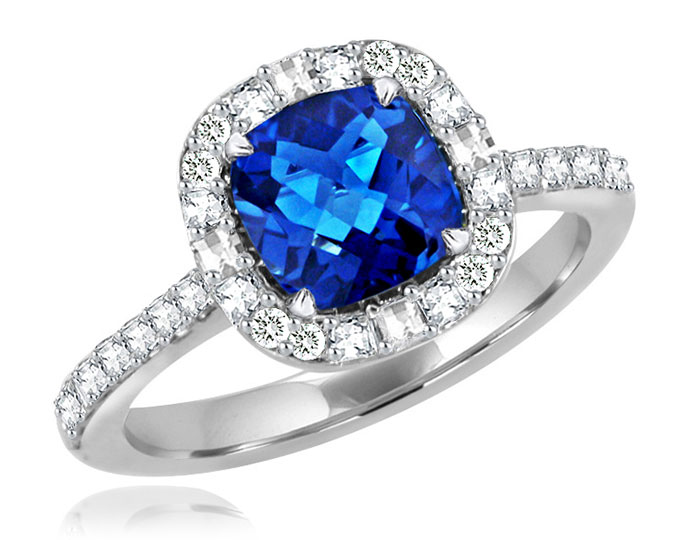 Sapphire, blaze cut diamond and round brilliant cut diamond ring in platinum.