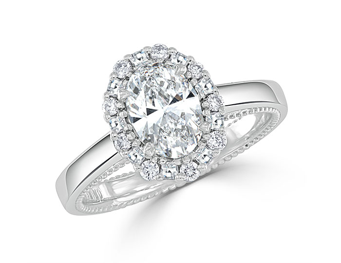 Bez Ambar oval, blaze cut and round brilliant cut diamond engagement ring in platinum.