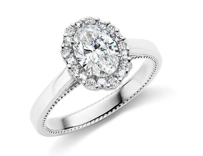 Oval, blaze cut and round brilliant cut diamond engagement ring in platinum.