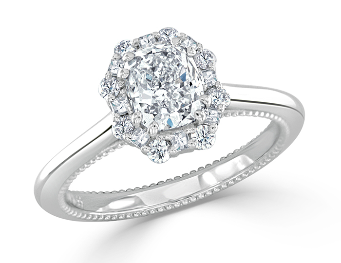 Cushion, blaze and round brilliant cut diamond engagement ring in platinum.