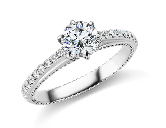 Bez Ambar round brilliant cut diamond diamond engagement ring in platinum.