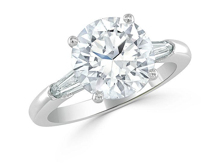 Round brilliant cut and bullet shape diamond engagement ring in platinum.