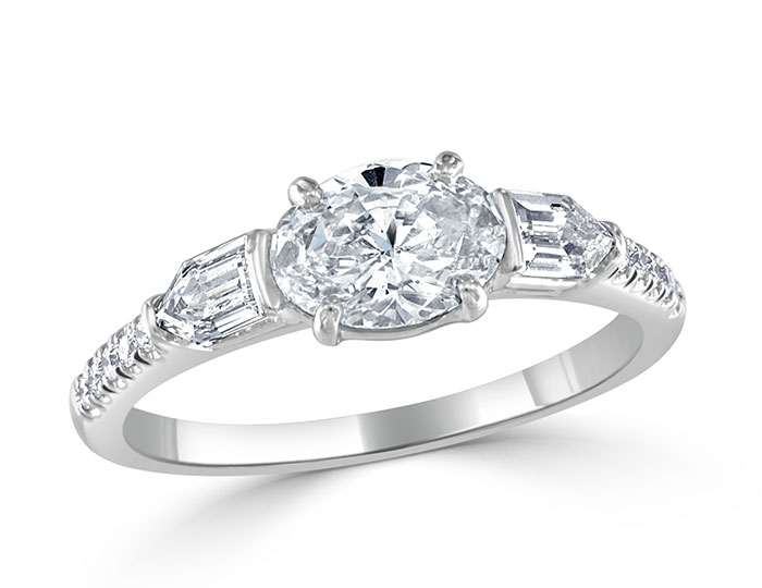 Ladies oval, bullet, and round brilliant cut diamond engagement ring in platinum.