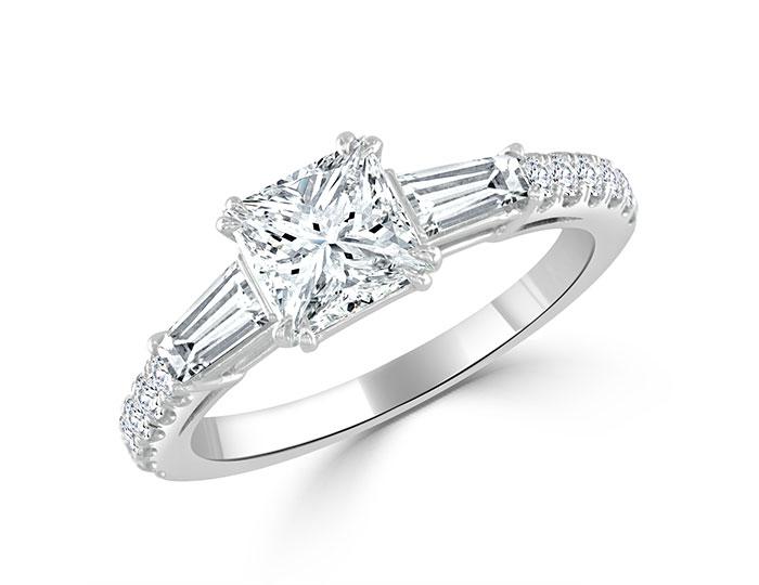 Bez Ambar princess cut, baguette, and round brilliant cut diamond engagement ring in platinum.
