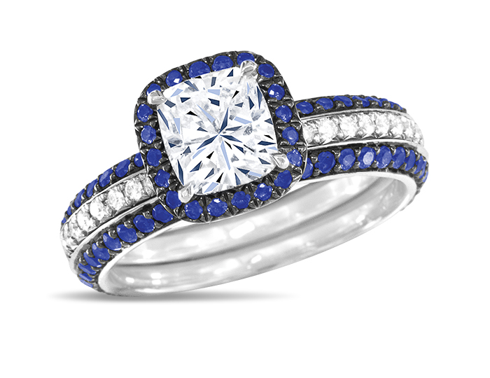 Cushion cut center diamond with sapphire and round brilliant cut diamond engagement ring in 18k white gold.  Sapphire bookend bands displayed with ring sold seperatly.