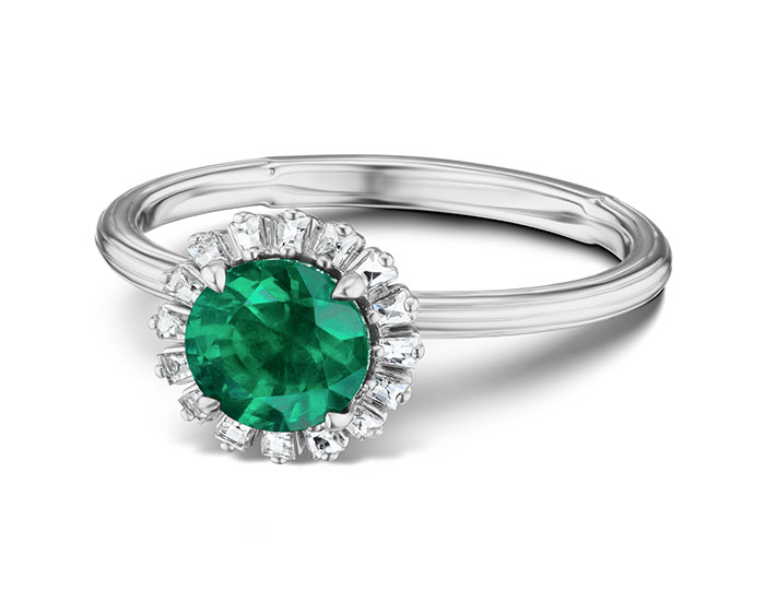 Emerald and blaze cut diamond ring in 18k white gold.