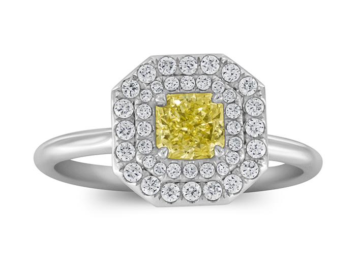 Fancy yellow radiant cut and round brilliant cut diamond engagement ring in 18k white gold.