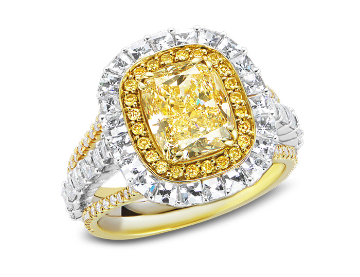 Natural fancy yellow cushion cut diamond engagement ring with blaze cut diamonds and round brilliant cut white and yellow diamonds in 18k yellow gold and platinum.