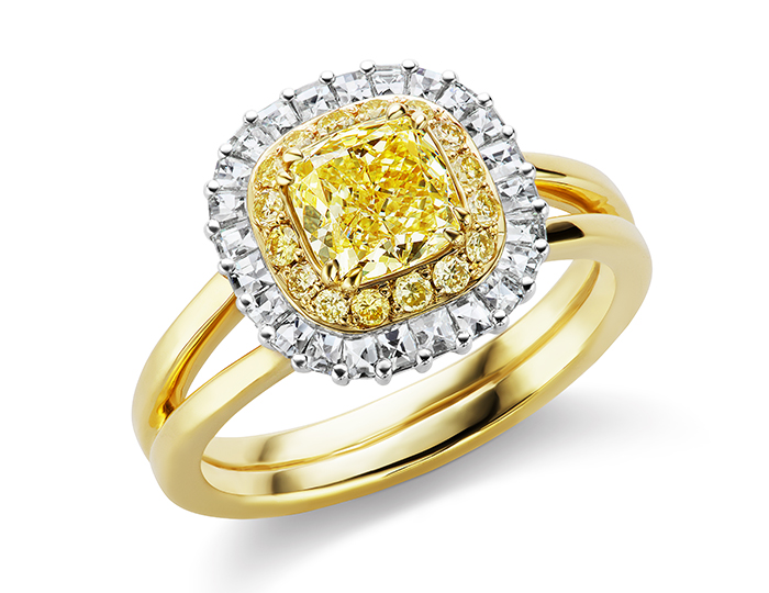 Natural fancy yellow cushion cut diamond engagement ring with blaze cut diamonds and round brilliant cut yellow diamonds in 18k yellow gold and platinum.