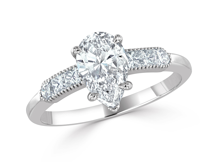 Pear shape and princess cut diamond engagement ring in 18k white gold.