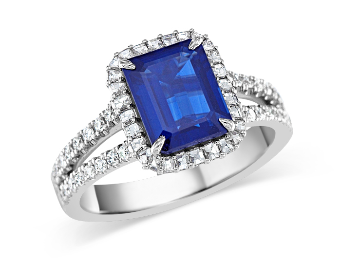 Round brilliant cut and blaze cut diamond and sapphire ring in 18k white gold.