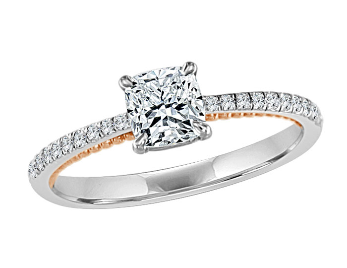 Cushion cut and round brilliant cut diamond engagement ring in 18k rose and white gold.